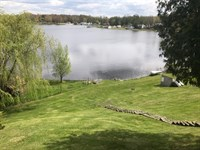 First Lake Frontage And Tidy Home : Six Lakes : Montcalm County : Michigan
