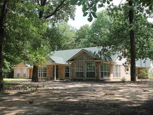 Custom Brick Surrounded By Trees : Deport : Lamar County : Texas